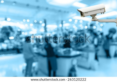 Security camera monitoring the cashier store blur with bokeh background - stock photo