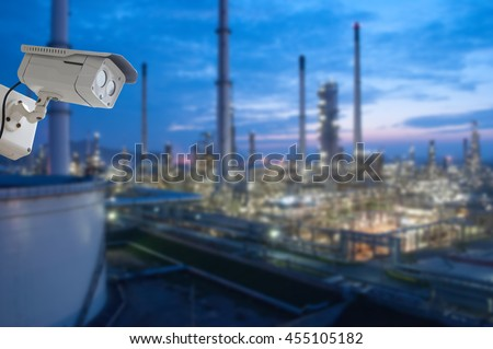 Security camera monitoring the Oil and gas refinery  - stock photo