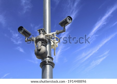 Security camera on blue sky   - stock photo