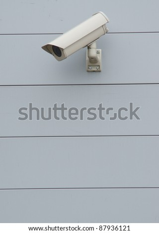 Security camera on the aluminum wall