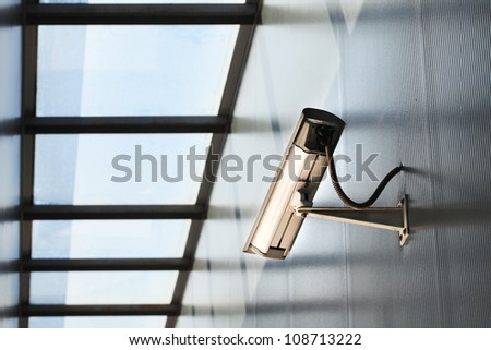 Security camera on the building. - stock photo