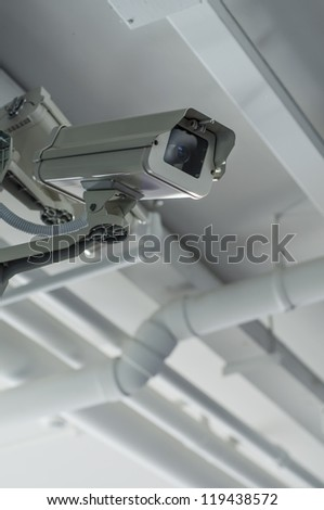 Security camera on the ceil with housing - stock photo
