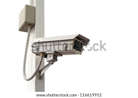 Security camera on the post with outdoor housing
