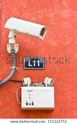 security camera on the wall, cctv - stock photo