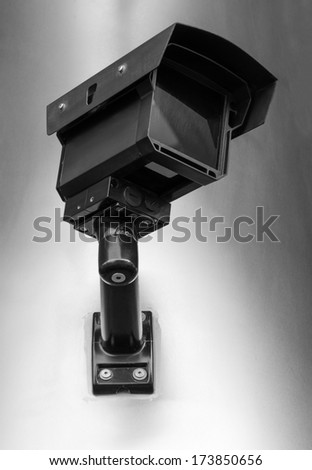 Security camera on the wall. Closeup. - stock photo