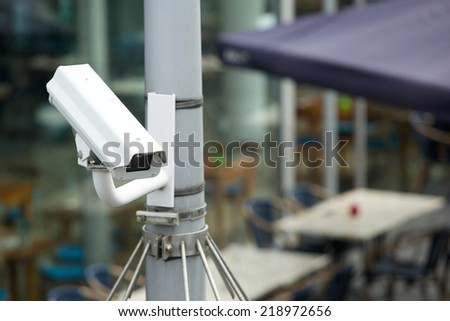 Security camera system attached to a pole outdoors - stock photo