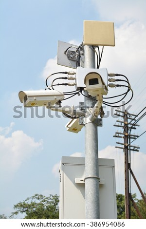 Security camera tower on blue sky background
