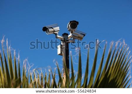 Security cameras, blue sky - stock photo