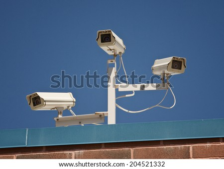 Security cameras on building  - stock photo