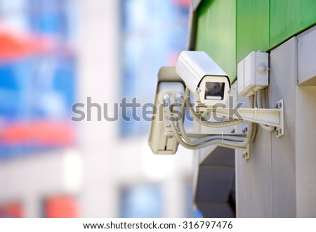 security cameras on the wall - stock photo