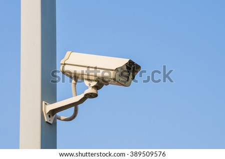 Security cameras or CCTV against blue sky - stock photo