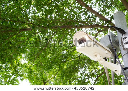 Security cameras or cctv camera in park and space for type text.