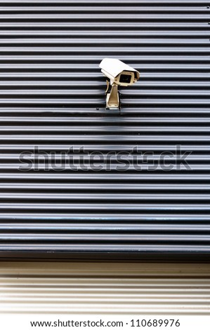 security cctv camera on textured wall - stock photo
