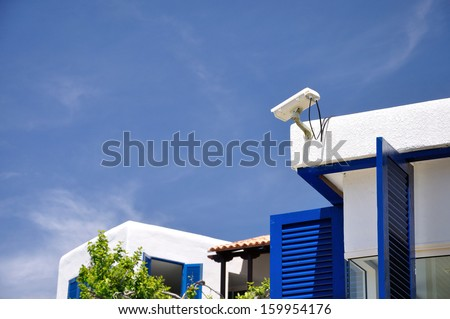 Security CCTV camera on the roof of resort. - stock photo