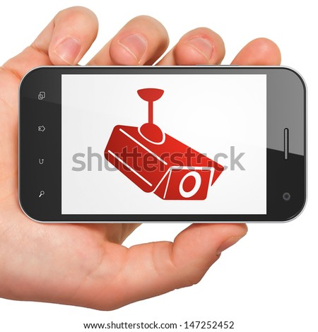 Security concept: hand holding smartphone with Cctv Camera on display. Generic mobile smart phone in hand on White background. - stock photo