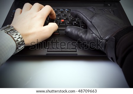 Security, cyber fraud and computer crime with hacker and businessman hands hacking internet - stock photo