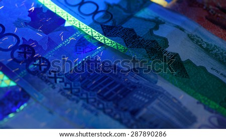 Security features on banknote in UV light protection, abstract background of money - stock photo
