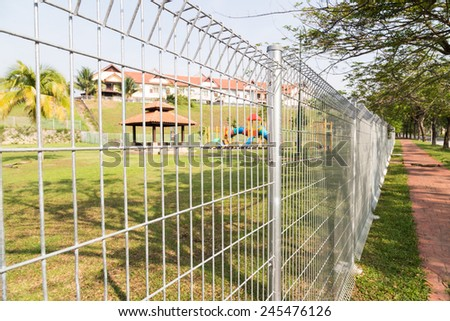 Security fencing at residential neighborhood  - stock photo