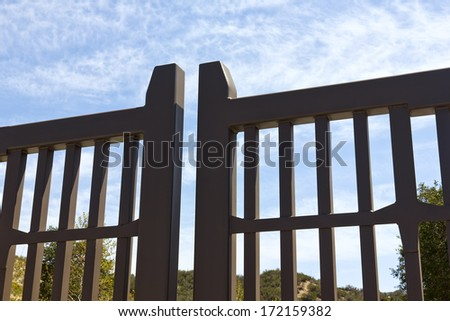 Security gate is close for access to a neighborhood.  - stock photo
