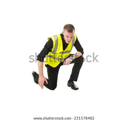 Security Guard / Bodyguard wearing a high visible vest - whit male with shaved head - stock photo