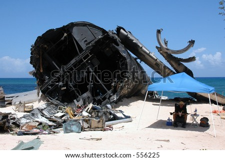 Security guard looks over the airplane crash site set for ABC's hit show LOST on the North Shore of Oahu, Hawaii. - stock photo