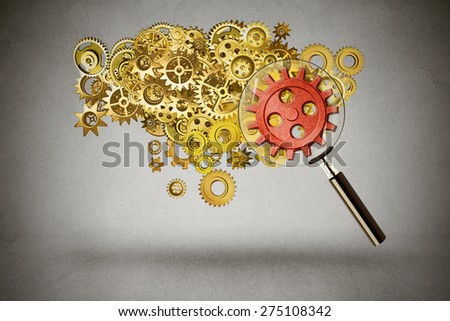 Security idea generation focus concept. Magnifying glass verifying a group of server gears representing internet protection from cyber crimes or teamwork leader concept  - stock photo