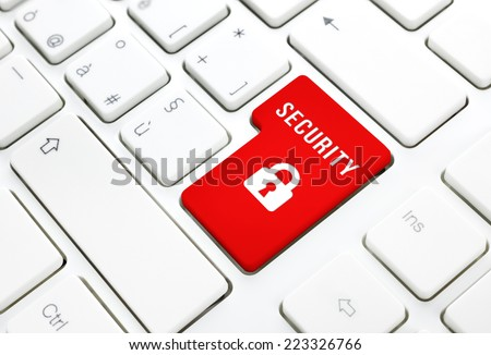 Security internet login concept, red enter button or key on white keyboard - stock photo