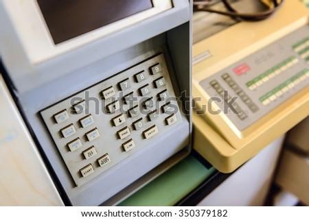 Security keypad closeup photo on a machine - stock photo