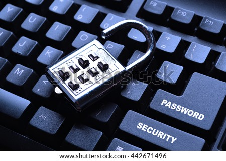 Security lock on black computer keyboard - stock photo