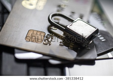 security lock on credit cards - stock photo