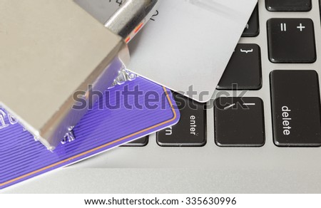 security lock on credit cards with computer keyboard / credit card data theft protection - stock photo