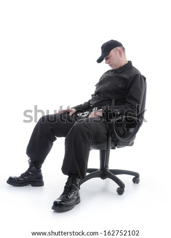 Security man sleeping on armchair shot on white - stock photo