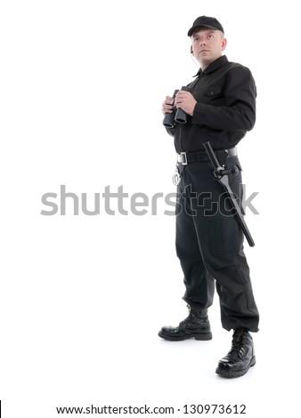 Security man wearing black uniform standing with binoculars, shot on white - stock photo