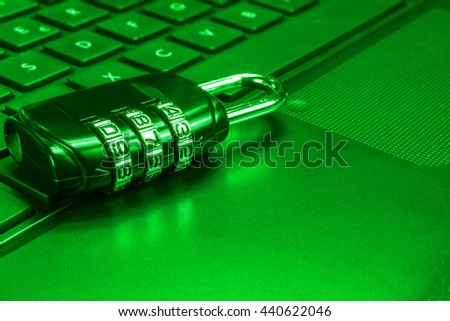 Security number lock on computer keyboard. Computer security concept. Green tone. - stock photo