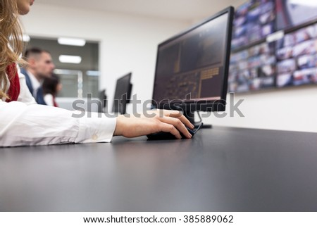 Security video surveillance. Control room operator. - stock photo