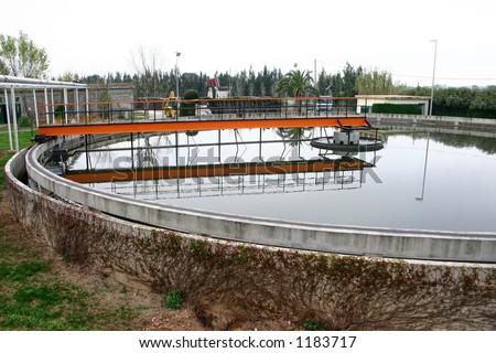 Sedimentation tank in wastewater treatment - stock photo