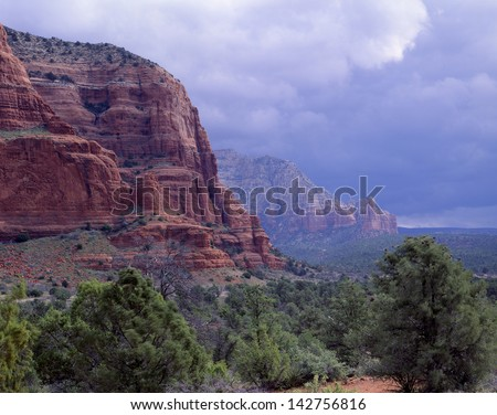 Sedona Arizona, Red Rock Secret Mountain Wilderness Area/red rock of Sedona/Court House butte in a full rain storm.  A hiking trail surrounds this butte. - stock photo