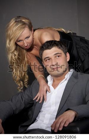 Seduction - Portrait of passionate couple in studio - stock photo