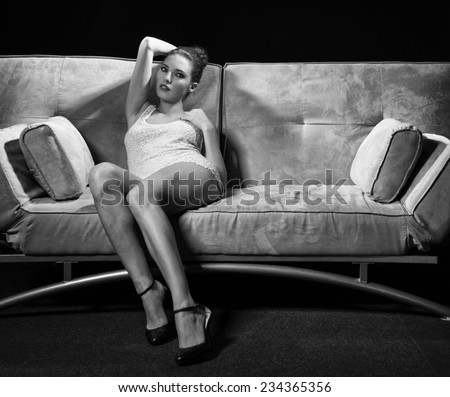 Seductive beautiful girl laying on the sofa. Seduction concept. - stock photo