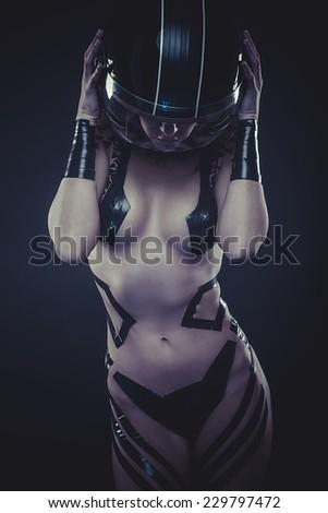 seductive beautiful woman with bike helmet, naked and black strips - stock photo
