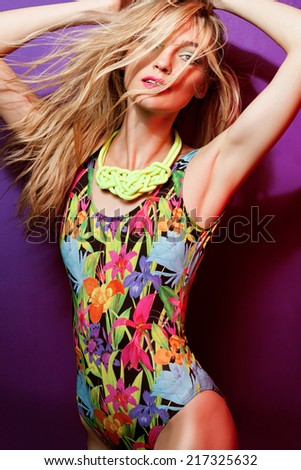 Seductive blond model in swimsuit - stock photo