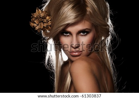 Seductive blond woman isolated on black background - stock photo