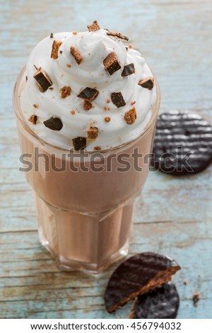 Seductive chocoltae milkshake with cookie crumbles on the top. Tasty mixture of ice cream, milk and chocolate. Whipped topping for better taste. - stock photo