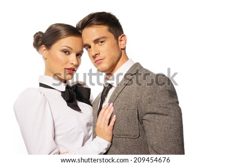 Seductive Couple Looking in Fashion at Camera on White Background. Emphasizing their Closeness. - stock photo