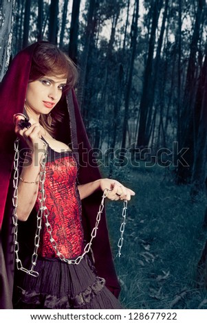 Seductive woman in a corset standing in a forest