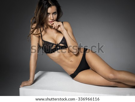 Seductive woman in black sexy lingerie