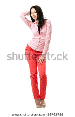 Seductive young brunette in red jeans. Isolated