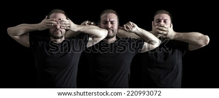 see hear speak no evil - Man on a black background - stock photo