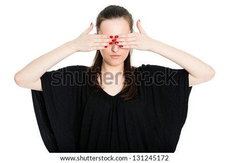 See no evil - attractive young brunette covering eyes with her hands, isolated on white background - stock photo
