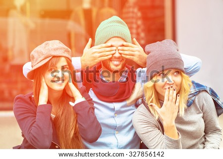 See no Evil, Hear no Evil, Speak no Evil, close-up portrait - Hipster happy friends enjoy a afternoon in the city with funny faces - Friendship of young people having fun together with vintage look - stock photo